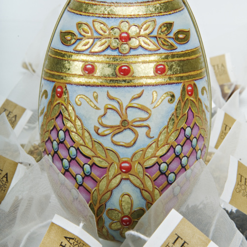 Easter Egg tin surrounded by teabags
