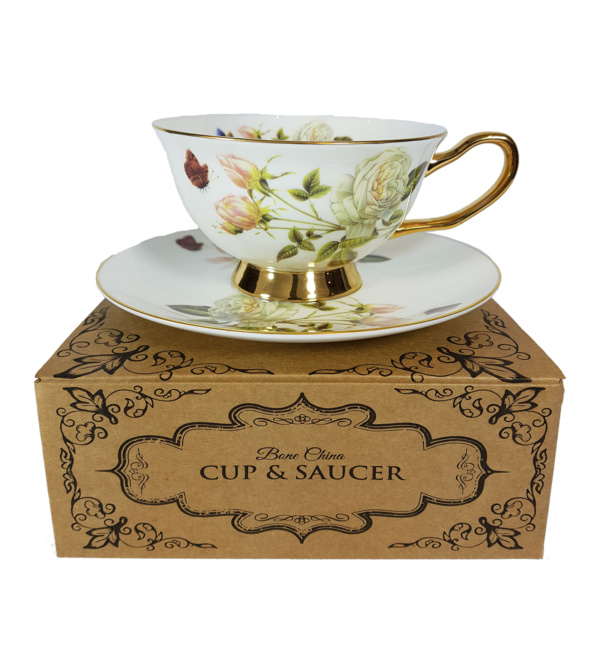 rose cluster cup and saucer on top of a gift box
