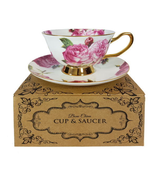 pink rose cup and saucer on top of gift box